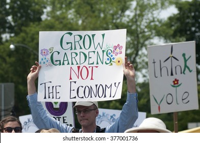 TORONTO - JULY 5 :Protesters demanding to grow garden instead of economy  during the Jobs,Justice and Climate rally on July  5, 2015 in Toronto, Canada.