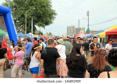 TORONTO - JULY 6: A diverse crowd at a street festival on July 6, 2013 in Toronto. About 50% of Toronto population belongs to a visible minority group.