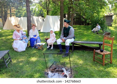 TORONTO - JUNE 15: The family in the camp at reenactment of the conflict of Revolutionary War between refugees and Loyalists at  Black Creek -  in June 15 2013 in Black Creek Village, Toronto, Canada