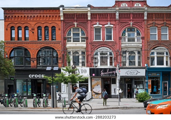 TORONTO - JUNE 2015:  The Queen-Spadina area has become the Greenwich Village of Toronto, with renovated Victorian buildings housing boutiques and restaurants, as seen in Toronto in June 2015.