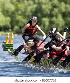 TORONTO - JUNE 21: KRG Insurance Brokers Dragon Boat racing at the21st TELUS Toronto International Dragon Boat Racing Festival at Toronto Island, June 20, 2009 Toronto, Canada.