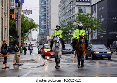 TORONTO - June 22, 2010:  Police officers on horses in downtown Toronto, Canada