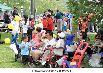 TORONTO - JUNE 23: Asian families in a park in a hot day on June 23, 2013 in Toronto. Based on 2011 census, there are 5.01 million Asian Canadian with the following ethnic identities.