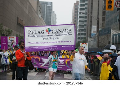 Toronto June 28, 2015 The 35th Toronto Pride Parade 2015 takes place along Bloor and Yonge Streets. Parade-goers line the streets and revellers party hard despite the rainy weather.