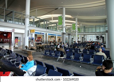 TORONTO - MARCH 1: A Toronto Pearson Airport waiting area on March 1, 2012 in Toronto. In 2011, Toronto Pearson handled 33.4 million passengers and 428,477 aircraft movements.