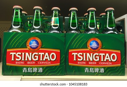 TORONTO - MARCH 11, 2018: Six pack bottles of Tsingtao Chinese beer, the best selling beer in the world.