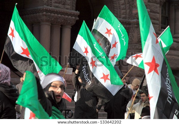 TORONTO - MARCH 16: Syrian demonstrators on March 16, 2013 in Toronto. Since March 2011, Syria has been embroiled in civil war in the wake of uprisings against Assad and the neo-Ba'athist government.