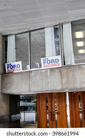 Toronto - March 30, 2016: Toronto City Hall, a darkened office, window displaying 'Rob Ford Councillor' signs.