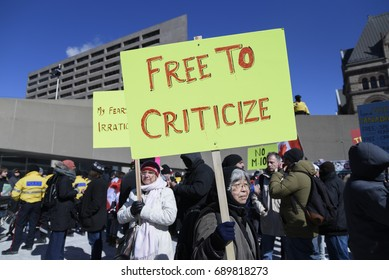 "TORONTO - March 4:  Anti Islam supporters  with banners saying ""free to criticize Islam"" during a pro and anti Muslim gathering on March 4, 2017 in Toronto, Canada."