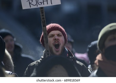 TORONTO - March 4:  A pro Muslim supporter chanting slogans during a pro and anti Muslim gathering on March 4, 2017 in Toronto, Canada.