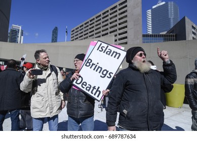 TORONTO - March 4:An Anti Muslim supporter chanting slogans towards the pro Muslim supporters during a pro and anti Muslim gathering on March 4, 2017 in Toronto, Canada.