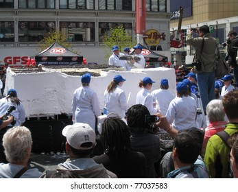 TORONTO - MAY 10: Dairy Queen makes the world's largest ice-cream cake on May 10, 2011 at Yonge Dundas Square in Toronto, Canada.