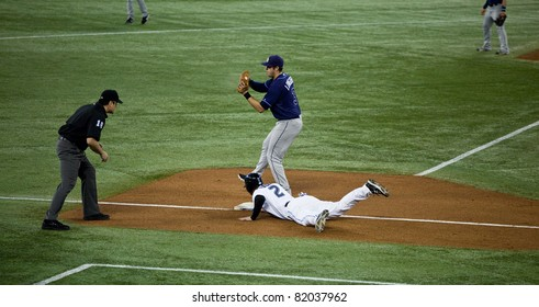 TORONTO - MAY 19: Tampa Bay Rays' player Evan Longoria at third base in a MLB game against the Toronto Blue Jays at Rogers Centre on May 19, 2011 in Toronto.  The Blue Jays won 3-2.