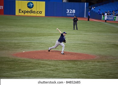 TORONTO - MAY 19: Tampa Bay Rays' player Wade Davis pitching in a MLB game against the Toronto Blue Jays at Rogers Centre on May 19, 2011 in Toronto.  The Blue Jays won 3-2.