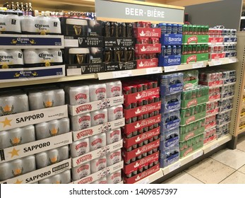 TORONTO - MAY 26, 2019: Beer on a retail liquor store shelf, neatly organized and colorful. International selection including examples from Polish, American, Canadian, Irish and Dutch beers.