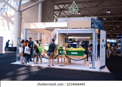 TORONTO - MAY 27: People discussing cannabis related technologies during the cannabis expo on May 27 2018 in Toronto, Canada.