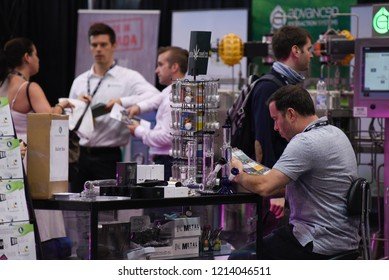 TORONTO - MAY 27: People discussing business opportunities regarding the  cannabis industry during the cannabis expo on May 27 2018 in Toronto, Canada.