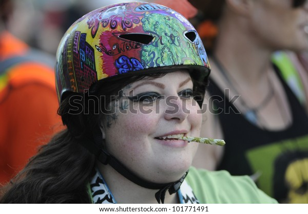 TORONTO - MAY 5:  A marijuana legalization activist with a marijuana cigarette during the    14th annual Global Marijuana March on May 5  2012 in Toronto, Canada.