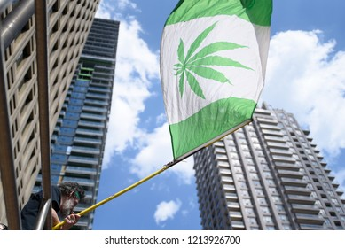 "TORONTO - MAY 5:  People waiving replica of ""Canadian Flag"" with a Marijuana leaf printed on it during the annual Global Marijuana March on May 5  2018 in Toronto, Canada."