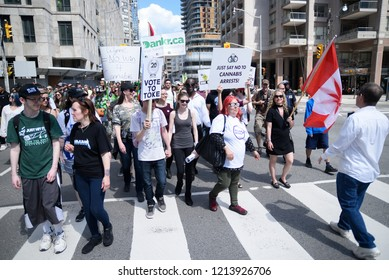 TORONTO - MAY 5:  People walking on the streets during the  annual Global Marijuana March on May 5  2018 in Toronto, Canada.