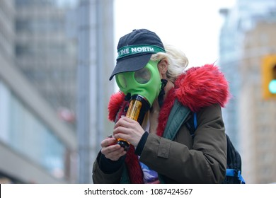 "TORONTO - May 6:  A girl wearing ""gas mask bong"" during the Global Marijuana March 2017 in Toronto on May 6, 2017 in Toronto, Canada."