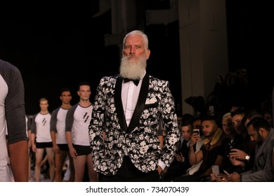 TORONTO : A model, Paul Mason (also known as Fashion Santa) walks the runway in the Finezza runway show for the Spring / Summer 2018 season at Toronto Men's Fashion Week on September 30, 2017