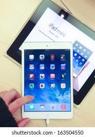 TORONTO - NOVEMBER 11: Custormer tries the iPad mini at the Apple Store in Toronto, Canada on November 11, 2013.