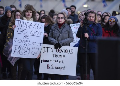 TORONTO - NOVEMBER 13: Women with signs to warn Canadian Prime Minister Justin Trudeau ABOUT Donald Trump during a protest rally on November 13, 2016 in Toronto, Canada.