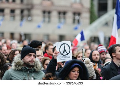 Toronto November 14, 2015 Crowds gather at Toronto's Nathan Phillips Square for a silent vigil this afternoon to honour those lost and injured in the terror attacks on Paris.