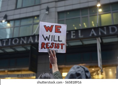 "TORONTO - NOVEMBER 19: A protester with sign saying ""we will resist"" during a protest in front of Trump Tower on November  19, 2016 in Toronto, Canada."