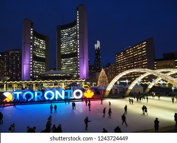 TORONTO - NOVEMBER 2018:  Civic square and skating rink in front of Toronto City Hall is brightly lit with Christmas decorations each year.
