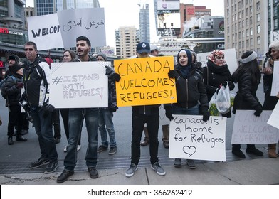 TORONTO - NOVEMBER 22: People, irrespective of their age and religion holding signs and banners during a solidarity rally to welcome Syrian refugees to Canada  on November 22, 2015 in Toronto,Canada.