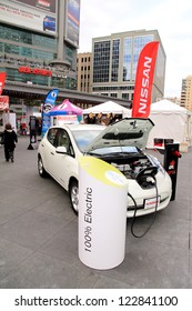 TORONTO - NOVEMBER 23: A street event promoting a 100% electric Nissan car on November 23, 2012 in Toronto. Over 4.6 of Nssan vehicles were sold globally in the year 2011.
