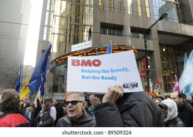 TORONTO - NOVEMBER 24:  Occupy Protesters standing in front of the Toronto Stock Exchange during a rally on November 24, 2011 in Toronto, Canada.