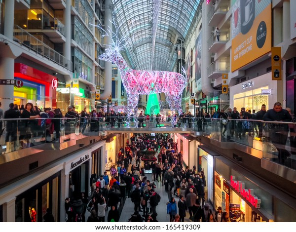 TORONTO - NOVEMBER 29: Shoppers visit the mall in Toronto, Canada on the Black Friday, November 29, 2013.