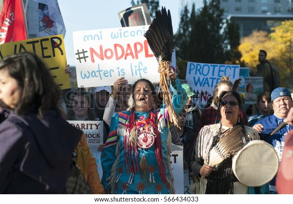 TORONTO - NOVEMBER 5: Indigenous community members walking while chanting slogans during a solidarity rally with the Dakota Access Pipeline protesters on November 5, 2016 in Toronto, Canada.