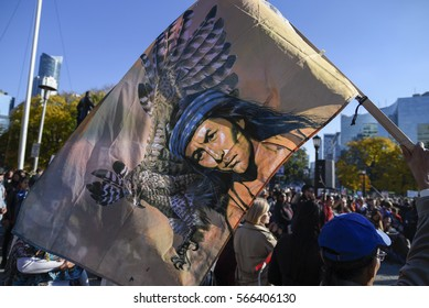 TORONTO - NOVEMBER 5: An indigenous supporter waiving an indigenous warrior flag  , during a solidarity rally with the Dakota Access Pipeline protesters on November 5, 2016 in Toronto, Canada.