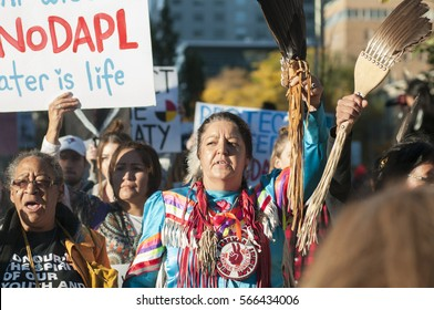 TORONTO - NOVEMBER 5: An Indigenous woman chanting slogans during a solidarity rally with the Dakota Access Pipeline protesters on November 5, 2016 in Toronto, Canada.