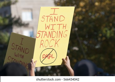 TORONTO - NOVEMBER 5: Participants holding solidarity messages during a solidarity rally with the Dakota Access Pipeline protesters on November 5, 2016 in Toronto, Canada.