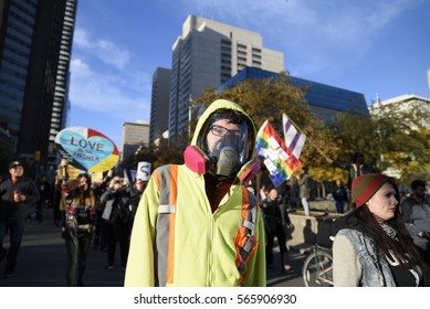TORONTO - NOVEMBER 5: A protester wearing a gas mask during a solidarity rally with the Dakota Access Pipeline protesters on November 5, 2016 in Toronto, Canada.