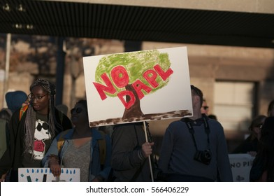 """TORONTO - NOVEMBER 5: Supporters with """"no dapl"""" signs walking during a solidarity rally with the Dakota Access Pipeline protesters on November 5, 2016 in Toronto, Canada."""