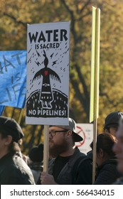 TORONTO - NOVEMBER 5: Supporters with signs urging authorities to protect water bodies during a solidarity rally with the Dakota Access Pipeline protesters on November 5, 2016 in Toronto, Canada.