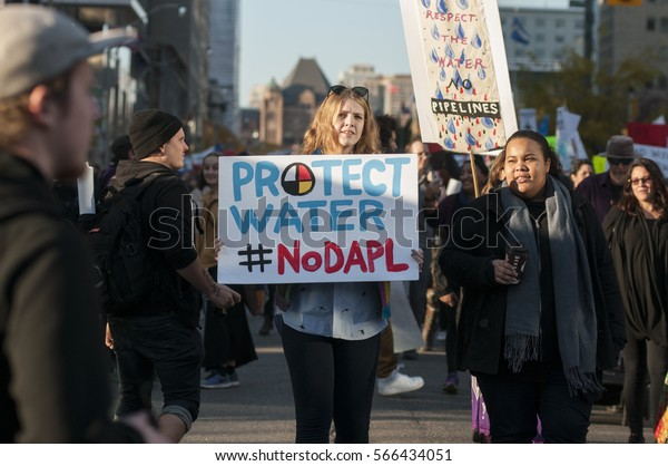 TORONTO - NOVEMBER 5: Supporters walking in rally to show solidarity rally with the Dakota Access Pipeline protesters on November 5, 2016 in Toronto, Canada.