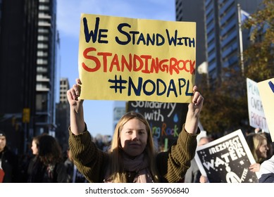 TORONTO - NOVEMBER 5: A woman walking with a solidarity message during a rally with the Dakota Access Pipeline protesters on November 5, 2016 in Toronto, Canada.