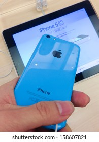 TORONTO - OCTOBER 15: Customer holds an iPhone 5c at the Apple Store in Toronto on October 15, 2013.