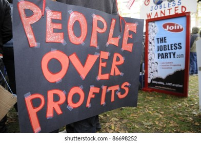 TORONTO - OCTOBER 15:  Protestors mocking the unemployment rate of Toronto with signs and banners  during the Occupy Toronto Movement on October 15, 2011 in Toronto, Canada.