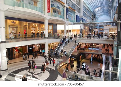 TORONTO - October 16, 2017: Shoppers Visit The Toronto Eaton Center, Interior Architecture Of Shopping Mall In Downtown Toronto, Crowded Stores