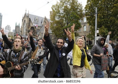 TORONTO - OCTOBER 17: Protestors clapping and chanting slogans  during the Occupy Toronto Movement on October 17, 2011 in Toronto, Canada.