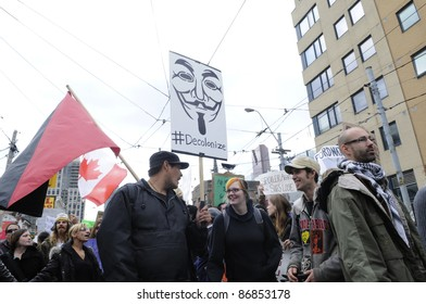 TORONTO - OCTOBER 17: Protestors marching in a rally during the Occupy Toronto Movement on October 17, 2011 in Toronto, Canada.