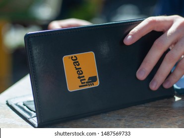 Toronto, On Canada August 25 2019, A Man pays for his bill using Interac.
